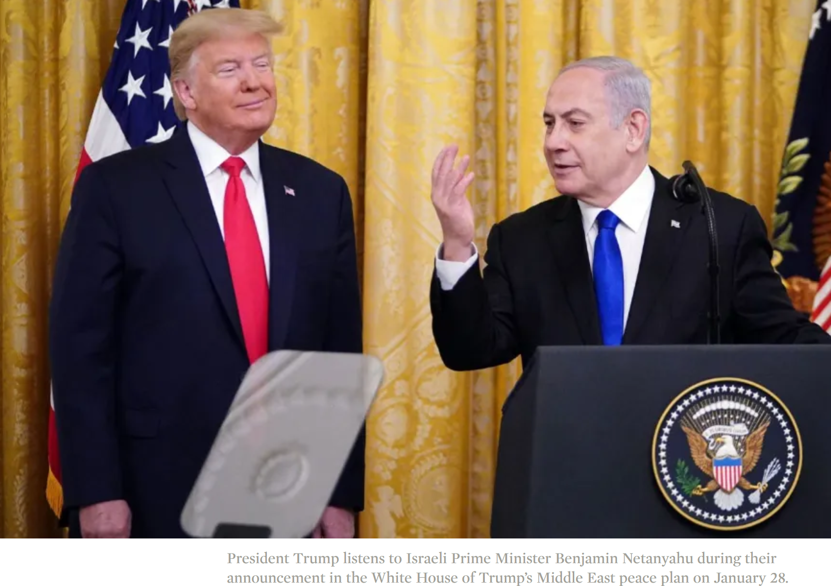 President Trump listens to Israeli Prime Minister Benjamin Netanyahu during their announcement in the White House of Trump's Middle East peace plan on January 28.
