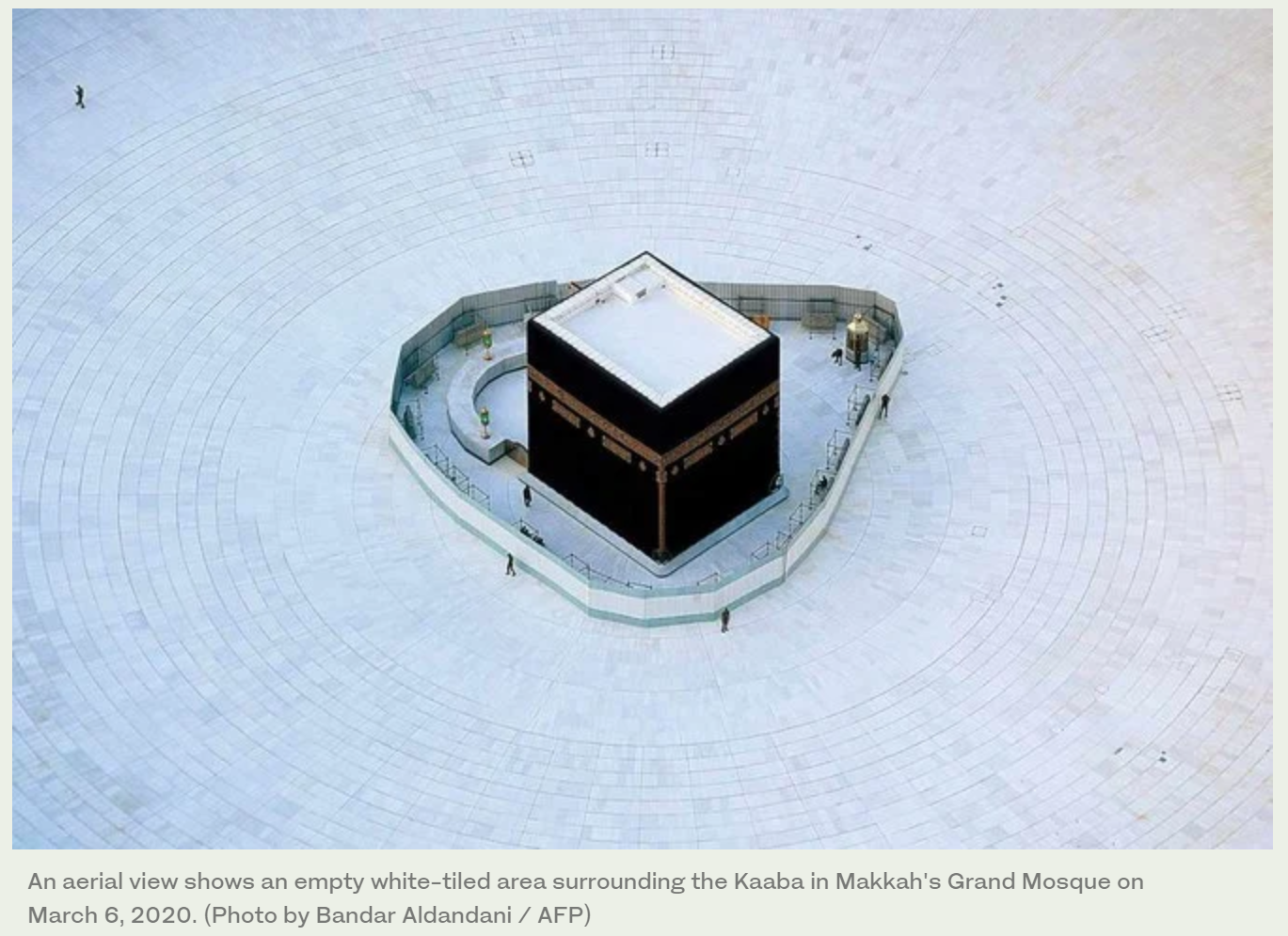 An aerial view shows an empty white-tiled area surrounding the Kaaba in Makkah's Grand Mosque on March 6, 2020.