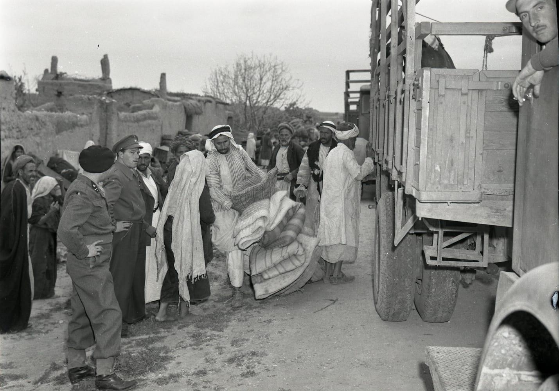 International forces overseeing the evacuation of Iraq al-Manshiyya, near today's Kiryat Gat, in March, 1949.