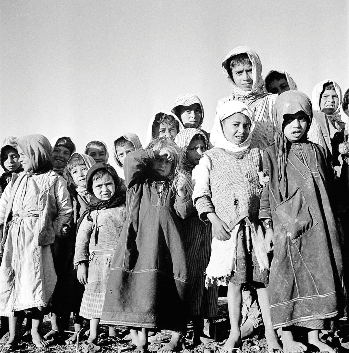 Palestinian children awaiting distribution of milk by UNICEF at the Nazareth Franciscan Sisters' convent, on January 1, 1950.