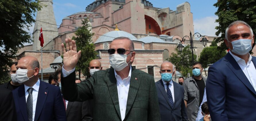 President of Turkey Recep Tayyip Erdogan (C) salutes public after a visit to inspect Hagia Sophia Mosque which will be opened on 24th of July for worship after 86 years with Friday prayer, in Istanbul, Turkey on 19 July 2020