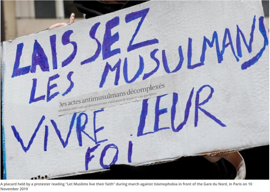 "A placard held by a protester reading ""Let Muslims live their faith"" during march against Islamophobia in front of the Gare du Nord, in Paris on 10 November 2019"