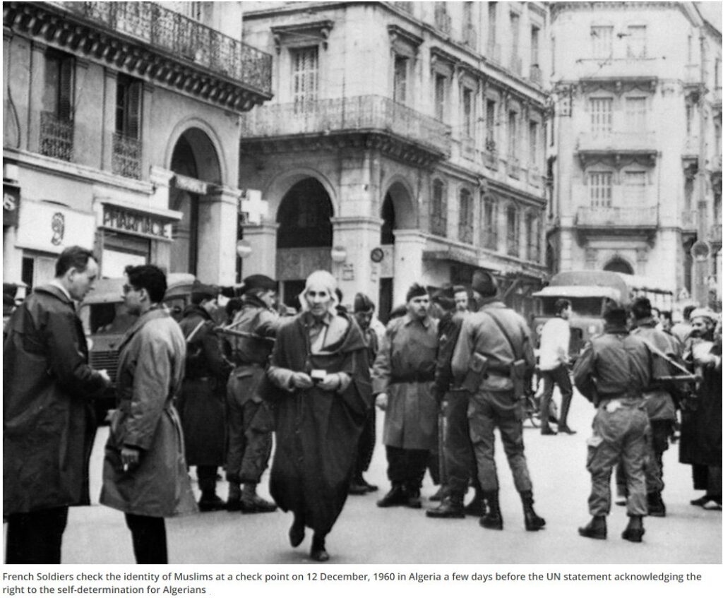 French Soldiers check the identity of Muslims at a check point on 12 December, 1960 in Algeria a few days before the UN statement acknowledging the right to the self-determination for Algerians