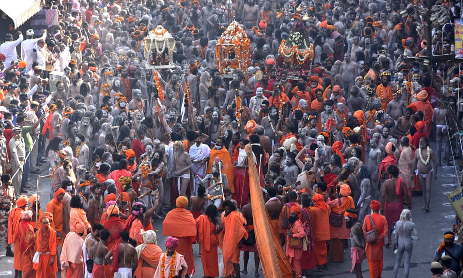 Indian holy men, or Naga Sadhu, make their way to take a holy dip in the Ganges River during the Kumbh Mela at Haridwar, Uttarakhand, India, on 14 April.