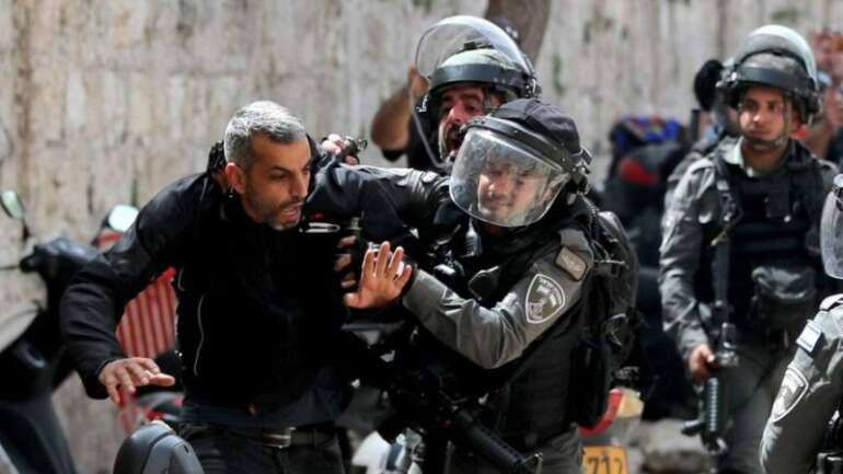 Israeli police detain a Palestinian man during clashes at the compound that houses the al-Aqsa Mosque in Jerusalem on Monday