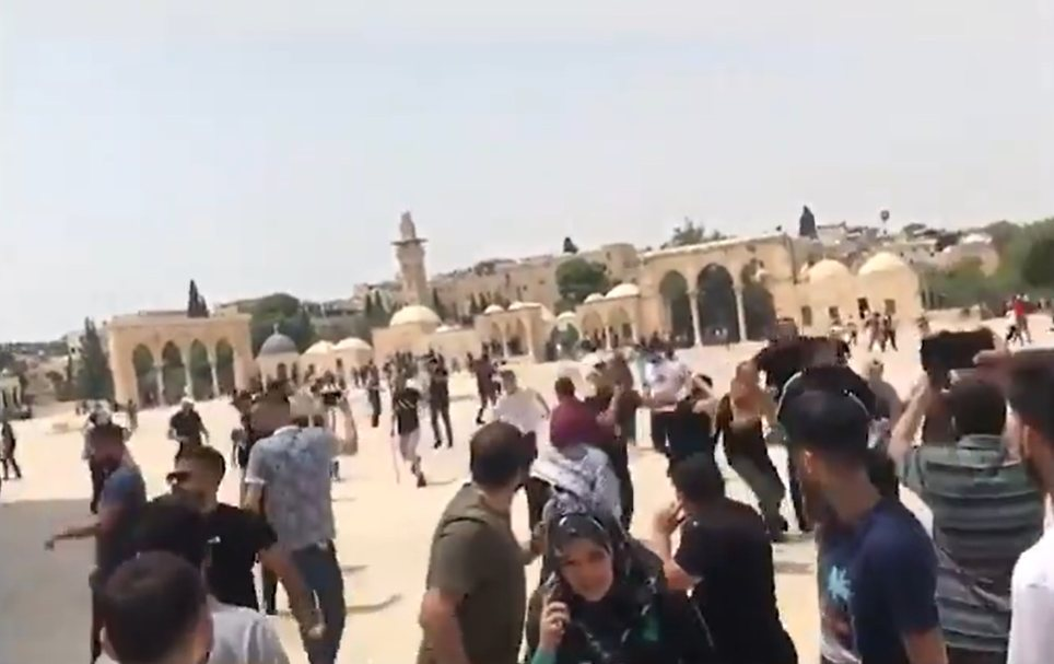 Israeli police throw stun grenades after Friday prayers at Al Aqsa Mosque on the first day of the ceasefire